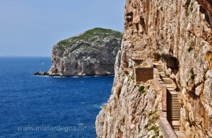 Stairways to stalactite cave of Neptune Grotto in Alghero in Sar