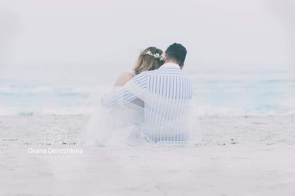Just-married couple on the summer beach, selective focus