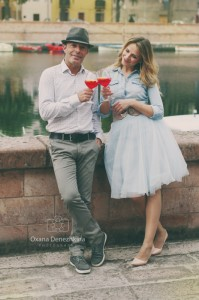 Lovely couple drinking apiritif in the small italian city, selective focus